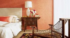 https://flic.kr/p/67jarQ | Peach bedroom from Metropolitan Home | I once subletted a room that was painted this color, and I don't think I've ever been happier waking up each morning. This is the master bedroom of a home in Rancho Mirage, California. And that isn't paint on the walls -- it's actually coral-hued Venetian plaster wallpaper! The interior designer, Sam Cardella, mixed periods and styles, placing a Murano glass lamp atop a Chinese bedside table, and an antique kilim under a…
