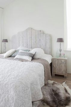 Bedroom. Chalk paint effects . Shabby chic..faux fur and fine linen.