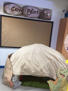 Dinosaur role play/ cave painting display. Reception-EYFS