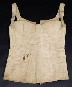 """1820-1840 Corset at the Glasgow Museums, Glasgow - From the curators' comments: """"After the high waistline of first two decades by the 1820s it was slowly returning to the natural waist. However, corsets at this date were still designed to produce a long slim line rather than the hour-glass figure with sixteenth inch waist that was fashionable during Queen Victoria's reign later in the century."""""""