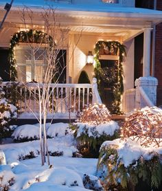 Great outside porch - large and has a Christmas atmosphere with the snow and lights! http://houseandhome.com/sites/houseandhome.com/files/imagecache/photo/top-images/galleries/1021589/Frontyard.jpg #MagicalHoliday #indigo