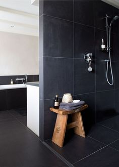 Shower stool to fill space in wall to wall shower? Good example of dark tile bathroom. Large Tile Bathroom, Bathroom Floor Tiles, Laundry In Bathroom, Grey Bathrooms, Beautiful Bathrooms, Master Bathroom, Shower Tiles, Room Tiles, Large Tile Shower
