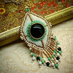 Bead embroidered pendant #jaumanna #Beaded #beading #beads #embroidery #colorful #hippie #boho #bohemian #buy #forsale #fashion #shopping #tutorials #tutorial #creative #craft #design #designer #bracelet #bracelets #pendant #pendants #earrings #bookmark #bookmarks #brooch #brooches