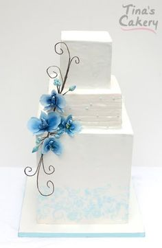 white square with blue swag flowers