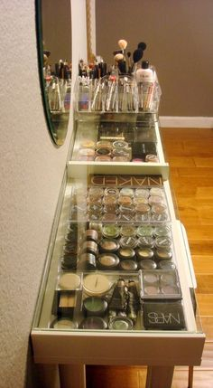 Ikea makeup storage.  Love the shiny clear cases.  Wouldn't look so great with my mishmash of drugstore cosmetics.