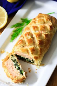 Salmon Wellington- salmon fillets and cheesy spinach wrapped in a flaky and buttery puff pastry. Perfect special occasion dinner or date night meal!