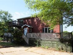 DIAMOND IN THE ROUGH ON LAKE COOLEY.  Two story home offering awesome lake views just perfect for any season featuring a wrap around deck with multiple staircases for all your lakefront liivng enjoyment.  This home features an open floor plan with floor to ceiling windows in the great room opening up into the kitchen where you will find granite countertops vegetable sink both an electric and gas stove pantry and a bar area with pendant and recessed lighting.  Also on the main level is a…