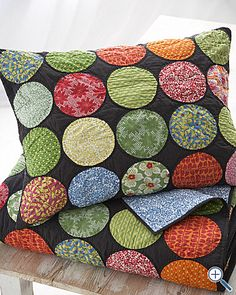 Been trying to find pillows that would bring in several colors in my living room and I think this is a great idea for that. These are small enough you could even cut down quilting squares that come in so many colors/patterns.