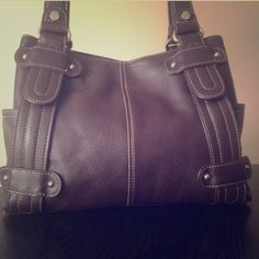 "⚱ Tignanello ⚱ ⚱ Tignanello - Studded Shopper, dark brown pebbled leather with silver hardware. There is a little wear it n the handles, otherwise in excellent condition!  *2 side pockets.  *Dual shoulder straps.  *1 main compartment w/ magnetic latch.  *3 inside pockets -- 2 slip pockets, 1 wall pocket.  *1 inside divider zip-pocket.  Approx measurements: 12"" x 9"" x 5"" with an 11"" SD. ⚱ Tignanello Bags Shoulder Bags"