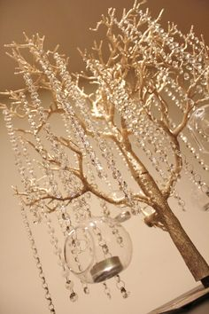 Customized Wedding Tree Wishing Tree Includes 2 1/2 Foot Tree, Hanging Glass Crystals, Hanging Bubble Orb Tealight Holders, Wishing Tags. $250.00, via Etsy.