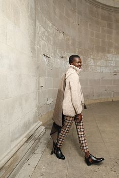 Band of Outsiders' wool ankle pants with M.Patmos' handwoven yak blanket and Nellie Partow's cashmere and wool hand-knit sweater. Shoes by The Office of Angela Scott. [Photo by George Chinsee]