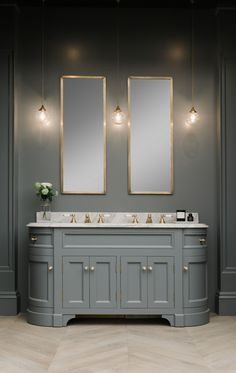 Double Stratford Vanity unit painted in BTWN dog and wolf paint and paper library marble vanity top in Liege Grey Polished.Classic Ogee Edge. Satin brass hardware, lights and mirrors. More