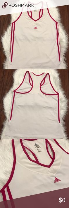 🎽Adidas Tank Top Size L🎽 Adidas racerback tank with shelf bra in hot pink and white. Worn a few times. In excellent used condition.   🎽EUC 👟TTS  ✨Smoke Free/Pet Free Home  💄NO Trades   Reasonable offers are welcome! Notify me with any questions. Feel free to bundle! Thanks for shopping my closet Adidas Tops Tank Tops