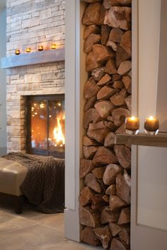 Cozy fireplace. The wood storage area would need to be lined with something other than a simple painted wall, however.