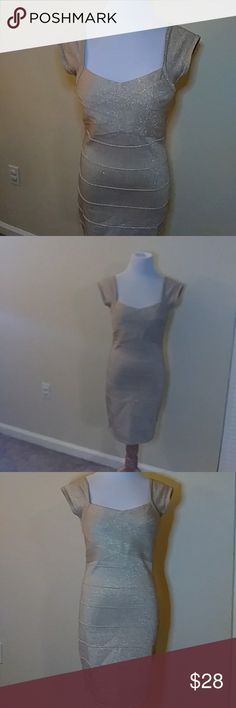 Forever 21 Gold glittery bandage dress Gold. Glittery. Flattering on. Stretchy material. 54% nylon. 32 % rayon. 9% polyester 5% metallic yarn. Beautiful dress. No rips, snags or stains. Pet and smoke free home. Never got around to wearing it. Make an offer :) Forever 21 Dresses Midi
