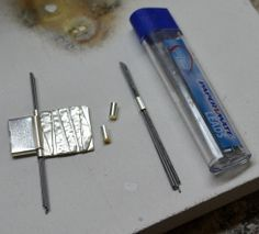 Pencil lead, it does not burn and holds small parts like tubing in place for soldering