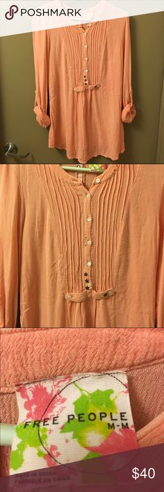 "Free People peasant style blouse size m! this is adorable! great condition. it is salmon colored and is a little sheer (I can get by with just a bra underneath, but a cami can be worn underneath if you wish). this top has cuffed sleeves, and buttons down the back. I am 5' 5"" and the bottom of this garment goes right past my butt. cute beading and stitching on the front! size medium, originally purchased from Free People for $98. Free People Tops Blouses"