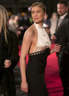 Star attraction: Actress Robin Wright looked sensational in a backless halterneck dress at the screening of House Of Cards in London on Thursday night