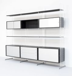 Poul Nørreklit; Stained Wood, Lucite, Aluminum and Chromed Metal Wall Unit, 1970s.