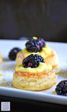 The cutest little pastry puff encases my incredibly easy-to-make Luscious Lemon Curd topped off with a sweet and juicy blackberry. Mini Desserts, Sweet Desserts, Easy Desserts, Dessert Recipes, Lemon Recipes, Tart Recipes, Sweet Recipes, Cooking Recipes, Dessert Simple