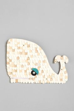 "UrbanOutfitters.com > White Whale by Dolan Geiman - Overview:  * Mixed media wall sculpture designed by Chicago-based artist Dolan Geiman  * Wood whale topped with scalloped leather and leatherette pieces  * Finished with a zipper accent  * Each piece is handmade in India and totally unique. Though each will look similar to the photo, they will vary slightly.  * Ready to hang  * 19.5""w, .5""d, 14""h      Content & Care:  * Wood, leather, polyurethane, metal"