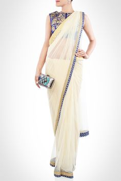 royal blue blouse, sleeveless blouse, closed neck blouse, off white saree, gold and blue border