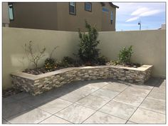 The client wanted a modern backyard with low maintenance landscaping. We delivered by using Belgard Mirage Porcelain pavers in Waterfall, Eldorado veneer stone, and a travertine bullnose capstone. A BBQ island with matching veneer and travertine completed this simple backyard.