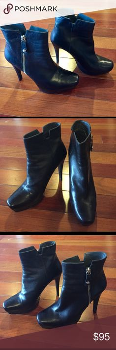 Stuart Weitzman leather booties Beautiful boots made in Spain! Overall condition 8/10. Has a 5 inch heel. Very minor scuff on the heel of the left boot. (pictured) Soles of the boots are still in perfect condition. Worn twice Stuart Weitzman Shoes Ankle Boots & Booties