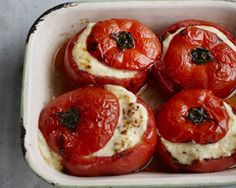 Maria Elias moussaka stuffed tomatoes are made by stuffing big beef tomatoes with aubergine, minced lamb, onion, garlic, lots of warming spices and a creamy bechamel sauce