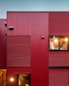 Here's a list (with photos) of 11 red houses and buildings from around that world that show architecture doesn't have to be boring and blend in. Metal Cladding, Metal Siding, Exterior Cladding, Metal Sheet Design, Red Houses, Warehouse Design, White Building, Corrugated Metal, Metal Buildings