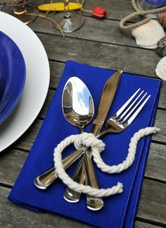 nook and sea-blue-bright-bold-table-setting-silverware-rope-tie-ring-wood-nautical-beach