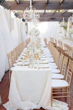 long white tables with gold details