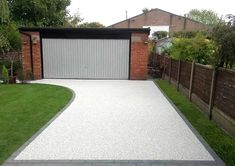 We are Manchester's Premier Installer of Resin Driveways, with the UK's largest indoor resin driveway showroom. Half Price Installation Offer Now On. Front Garden Ideas Driveway, Modern Driveway, Front House Landscaping, Driveway Design, Driveway Landscaping, Resin Driveway, Resin Patio, Driveway Paving, Concrete Driveways