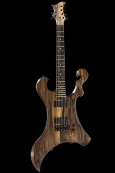 The custom 7 string guitar's entire front face showing killswitch, Seymour Duncan Blackouts and Hipshot hardtail bridge