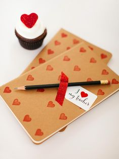 Show a little love to your children's teachers by creating this cute journal and pencil set. Have your child decorate the cover using a small heart stamp, and attach a pencil using washi tape or ribbon. Top with our printable teacher tag for the perfect sweet gift!