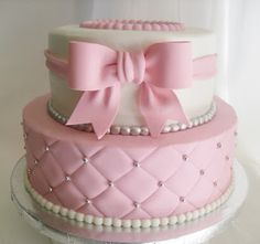 Quilted pink and white baby shower cake