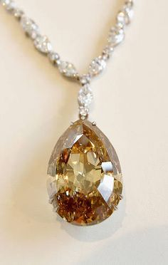 The Great Chrysanthemum is a 104.15 carat fancy brown-orange, pear shape diamond.