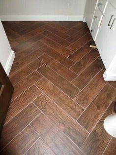 Wood look tile installed herringbone style