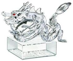 Swarovski Crystal Zodiac Dragon in clear crystal. The dragon is believed in ancient China to have been the reincarnation of the Emperor thus considered very majestic and powerful. This Swarovski Zodiac Dragon would make a great gift for someone born in the year of the Dragon. Here are a few designated years of the Dragon: 1916, 1928, 1940, 1952, 1964, 1976, 1988, 2000, 2012