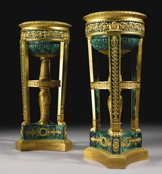 A rare pair of Restauration Ormolu and Malachite Athéniennes circa 1823, signed Thomire a Paris Pierre-Philippe Thomire (1751-1843) height 23 1/4 in.; diameter 10 1/4 in. 59 cm; 26.5 cm