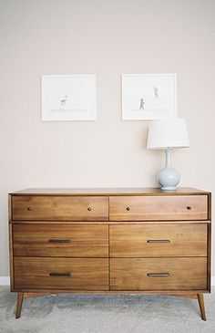 Love how this simple wooden dresser looks in this neutral nursery!