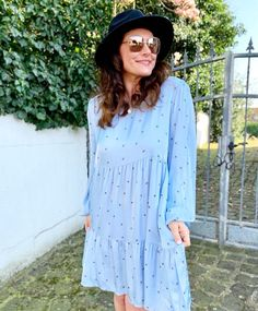 Printed swing dress and fedora | For more style inspiration visit 40plusstyle.com