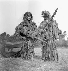 England, May 17, 1944, two Canadian snipers with their amazing camouflage holding!