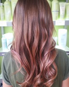 This dreamy shade of rose gold hair color and soft, flowy curls make a perfect pair. Stylist: @tiffanylstyles. Aveda color formula in the comments.