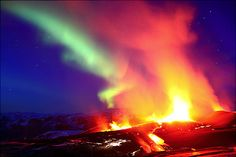 Feb 2012 – British photographer James Appleton captured the country's Fimmvorduhals volcano spewing molten lava under an equally molten Aurora sky. Northern Lights Holidays, Northern Lights Iceland, Volcan Eruption, Erupting Volcano, Night Sky Photos, Space And Astronomy, Wild Nature, Nature Images, Ciel