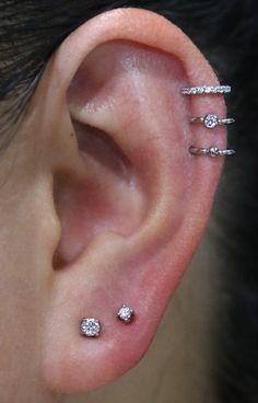 Ideas for ear piercings. Double piercings and unique. Ideas for ear piercings. Double piercings and unique piercings including helix, rook and lobe. Innenohr Piercing, Spiderbite Piercings, Double Helix Piercing, Ear Peircings, Piercings For Girls, Unique Piercings, Helix Piercing Jewelry, Helix Earrings Hoop, Helix Hoop