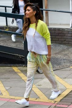 Nicole Scherzinger looked bright and fresh in a sporty yellow-and-white mesh-like DEX top paired with loose-fitting Forever Unique pants wit...