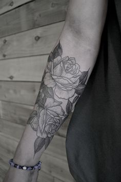 Roses three of them in my inner arm with all our birth month stones for rose color