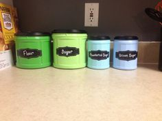 Folger's coffee containers painted and modge podged to seal it. The stickers were from target and written using a paint pen. Cute and inexpensive! Really happy with how they turned out