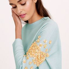 Sequin floral sweater. Only if it's white